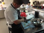 Andrew Cowmeadow HVTTC Cert III Commercial Cookery student preparing Abtas abalone