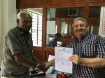 S.Venuji, President, Vakkom Grama Panchayat and Roy Palmer with the letter authorizing the project